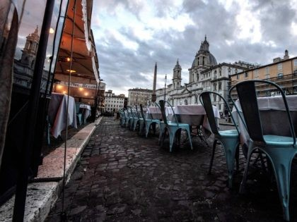 This picture shows a general view of Piazza Navona with empty restaurants in Rome on October 26, 2020, as the country faces a second wave of infections to the Covid-19 (the novel coronavirus). - Italy's Prime Minister Giuseppe Conte tightened nationwide coronavirus restrictions on October 25, 2020 after the country …