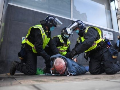 LONDON, ENGLAND - NOVEMBER 28: A man is seen being arrested during a protest on November 28, 2020 in London, England. London is to return to 'Tier 2' or 'high alert' covid-19 restrictions once the current England-wide coronavirus lockdown ends next Wednesday. All three of the tiers, assigned to local …