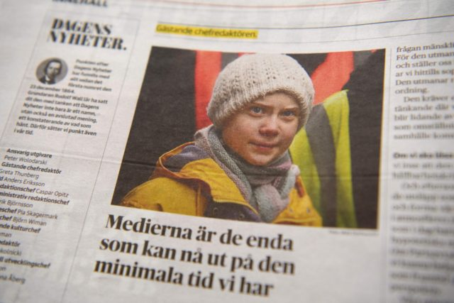The daily Swedish newspaper Dagens Nyheter is pictured on December 6, 2020 in Stockholm as climate activist Greta Thunberg, 17, is the editor-in-chief for a day. - Of the newspaper's almost one hundred pages, more than half are devoted to the climate crisis. (Photo by Henrik MONTGOMERY / TT News …