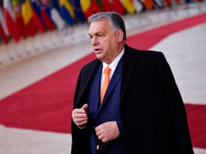 Hungary's Prime Minister Viktor Orban speaks to the press as he arrives at the EU headquarters' Europa building in Brussels on December 10, 2020, prior to a European Union summit. (Photo by JOHN THYS / POOL / AFP) (Photo by JOHN THYS/POOL/AFP via Getty Images)