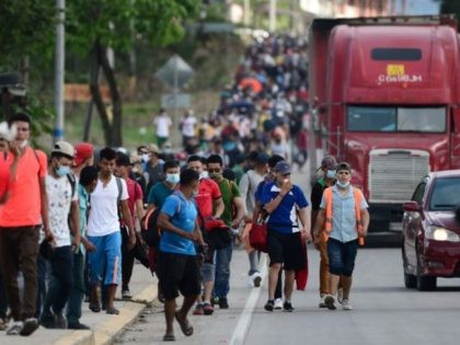Migrants heading to the border with Guatemala on their way to the United States, march in La Entrada, in the Honduran department of Copan, on January 15, 2021. - Hundreds of asylum seekers are forming new migrant caravans in Honduras, planning to walk thousands of kilometers through Central America to …
