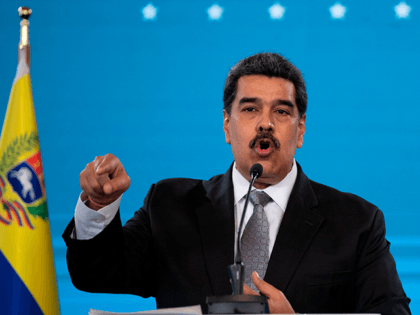 Venezuelan President Nicolas Maduro gestures while speaking during a press conference at Miraflores Presidential Palace in Caracas on February 17, 2021. - Venezuela will start its vaccination campaign against COVID-19 on February 18, after the arrival of the first 100,000 doses of Russian Sputnik V vaccines, including in this first …