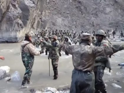 This video frame grab taken from footage recorded in mid-June 2020 and released by China Central Television (CCTV) on February 20, 2021 shows Chinese (foreground) and Indian soldiers (R, background) during an incident where troops from both countries clashed in the Line of Actual Control (LAC) in the Galwan Valley, …
