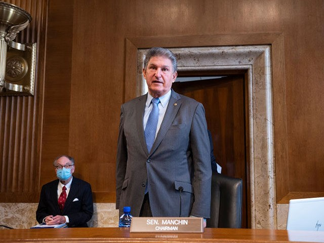 WASHINGTON, DC - FEBRUARY 23: Chairman Joe Manchin, D-WV, speaks to Congresswoman Deb Haaland, D-NM, during the Senate Committee on Energy and Natural Resources hearing on her nomination to be Interior Secretary on Capitol Hill on February 23, 2021 in Washington, DC. If confirmed, Haaland would become the first Native …
