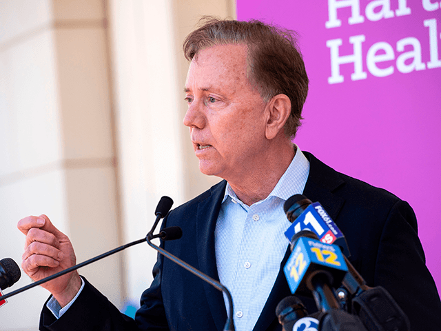 """Connecticut Governor Edward Miner """"Ned"""" Lamont Jr. (D) speaks about the states efforts to get more people vaccinated at Hartford HealthCare St. Vincent's Medical Center in Bridgeport, Connecticut on February 26, 2021. - Nine local clergy members were given the Pfizer-BioNTech Covid-19 Vaccine, aiming to educate and inspire their parishioners and minority communities to get vaccinated. (Photo by Joseph Prezioso / AFP) (Photo by JOSEPH PREZIOSO/AFP via Getty Images)"""