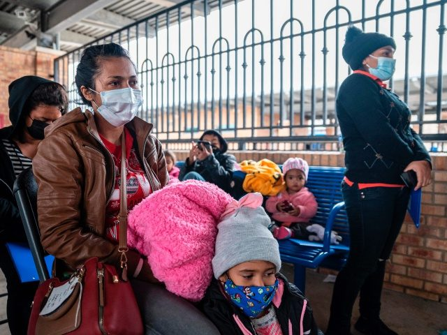 Migrant families wait for their bus at a bus station in Brownsville, Texas before travelling to meet relatives or sponsors on March 2, 2021. - President Biden announced that he was ending the Migrant Protection Protocol (MPP) enacted under President Trump that sent asylum seekers back to Mexico as they …
