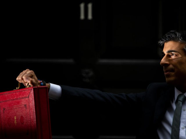 LONDON, ENGLAND - MARCH 03: Chancellor Of The Exchequer, Rishi Sunak stands with the Budget Box outside 11 Downing Street ahead of the Chancellor of the Exchequer's delivery of the budget on March 3, 2021 in London, England. The Chancellor, Rishi Sunak, presents his second budget to the House of …