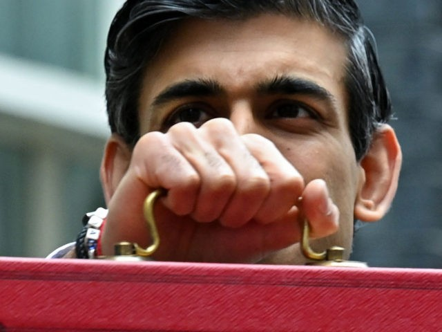 Britain's Chancellor of the Exchequer Rishi Sunak poses with the Budget Box as he leaves 11 Downing Street before presenting the government's annual budget to Parliament in London on March 3, 2021. - British finance minister Rishi Sunak unveils his annual budget today promising measures to safeguard businesses and jobs, …