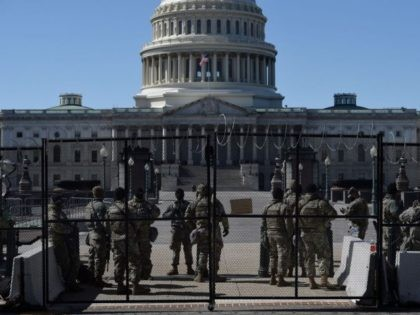 Members of the National Guard watch a checkpoint on Capitol Hill on March 5, 2021, in Washington, DC. - Armed US National Guard troops patrolled the US Capitol on March 4 after officials warned of a new attack plot by extremists, but the feared show of force by those still …