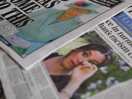 An arrangement of UK daily newspapers photographed as an illustration in Brenchley, Kent on March 9, 2021, shows front page headlines reporting on the story of the interview given by Meghan, Duchess of Sussex, wife of Britain's Prince Harry, Duke of Sussex, to Oprah Winfrey, which aired on UK broadcaster …