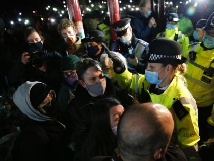 LONDON, ENGLAND - MARCH 13: Police officers attend during a vigil for Sarah Everard on Clapham Common on March 13, 2021 in London, United Kingdom. Vigils are being held across the United Kingdom in memory of Sarah Everard. Yesterday, the Police confirmed that the remains of Ms Everard were found …