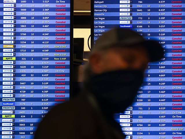 Risky  winter storm batters western USA  as airport, highways shut down