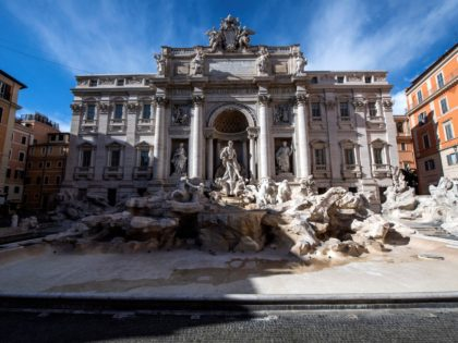 A picture shows the Trevi fountain without water in central Rome on March 15, 2021, after most of Italy re-entered into lockdown restrictions aimed at curbing the spread of the Covid-19 (novel coronavirus) pandemic. - Italy's government on March 12 announced tough new restrictions for much of the country following …