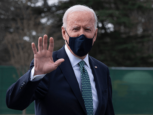 US President Joe Biden gestures as he walks off Marine One upon his arrival at the White House in Washington, DC, on March 17, 2021. (Photo by JIM WATSON / AFP) (Photo by JIM WATSON/AFP via Getty Images)