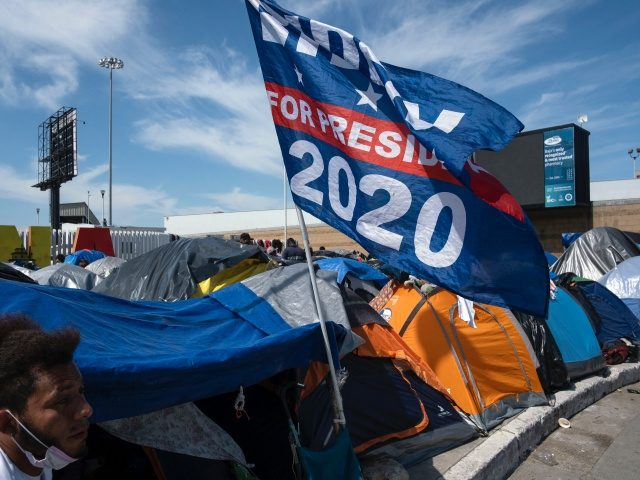 A US President Joe Biden campaign flag is seen at a migrants camp where asylum seekers wait for US authorities to allow them to start their migration process outside El Chaparral crossing port in Tijuana, Baja California state, Mexico on March 17, 2021. - President Biden's pledge of a more …