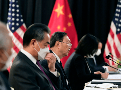 The Chinese delegation led by Yang Jiechi (C), director of the Central Foreign Affairs Commission Office and Wang Yi (2nd L), China's Foreign Minister, speak with their US counterparts at the opening session of US-China talks at the Captain Cook Hotel in Anchorage, Alaska on March 18, 2021. - China's …