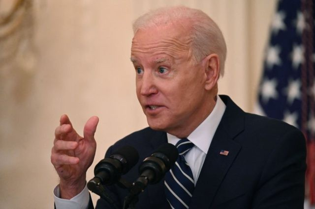 """US President Joe Biden speaks during his first press briefing in the East Room of the White House in Washington, DC, on March 25, 2021. - Biden said Thursday that the United States will """"respond accordingly"""" if North Korea escalates its missile testing. (Photo by Jim WATSON / AFP) (Photo …"""
