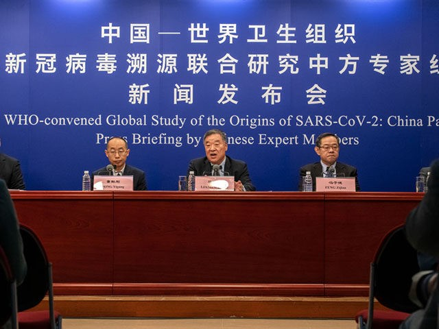 BEIJING, CHINA - MARCH 31: Head of the Expert Group on Covid Response at China's National Health Commission Liang Wannian (C) answers a question during a press conference at the National Health Committee on March 31, 2021 in Beijing, China. The Chinese COVID-19 response team held a press conference to …
