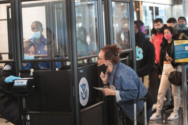 CHICAGO, ILLINOIS - OCTOBER 19: A Transportation Security Administration (TSA) agent screens an airline passenger at O'Hare International Airport on October 19, 2020 in Chicago, Illinois. Yesterday the TSA reported that it had screened over 1 million passengers, representing the highest number of passengers screened at TSA checkpoints since March …