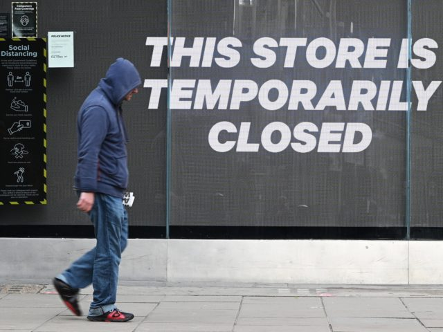 LONDON, UNITED KINGDOM - NOVEMBER 05: A man walks past a temporarily-closed clothing store on Oxford Street on November 05, 2020 in London, United Kingdom. England enters its second national coronavirus lockdown today. People are still permitted to exercise with one other person, takeaway food is permitted but bars and …