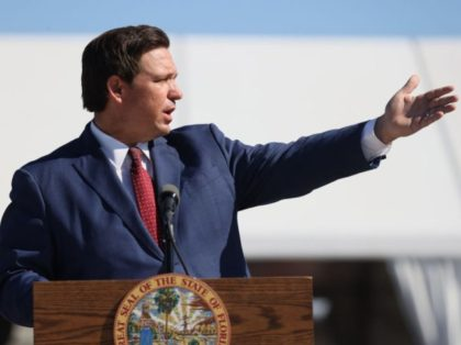 MIAMI GARDENS, FLORIDA - JANUARY 06: Florida Governor Ron DeSantis speaks during a press conference about the opening of a COVID-19 vaccination site at the Hard Rock Stadium on January 06, 2021 in Miami Gardens, Florida. The governor announced that the stadium's parking lot which offers COVID-19 tests will begin …