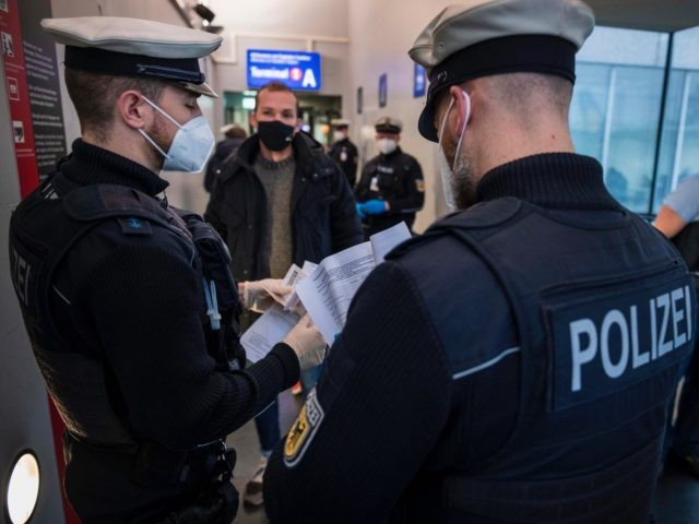 FRANKFURT AM MAIN, GERMANY - JANUARY 28: Border police check passengers arriving on a flight from Spain to be sure they can show evidence of a recent COVID-19 test at Frankfurt Airport during the second wave of the coronavirus pandemic on January 28, 2021 in Frankfurt, Germany. German Interior Minister …