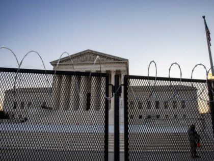 WASHINGTON, DC - FEBRUARY 08: The US Supreme Court is seen as National Guard secure the the grounds on February 08, 2021 in Washington, DC. Trump faces a single article of impeachment that accuses him of incitement of insurrection on the Jan. 6 riot at the US Capitol, which left …
