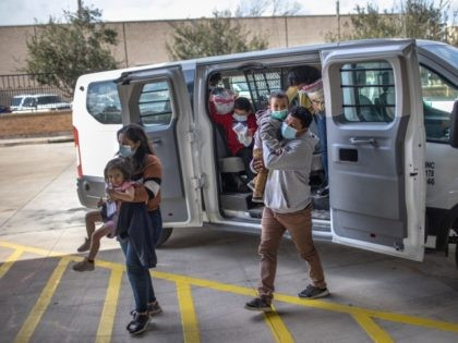 BROWNSVILLE, TEXAS - FEBRUARY 26: Asylum seekers are released by the U.S. Border Patrol at a bus station on February 26, 2021 in Brownsville, Texas. U.S. immigration authorities are now releasing many asylum seeking families after they cross the U.S.-Mexico border and are taken into custody. The immigrant families are …