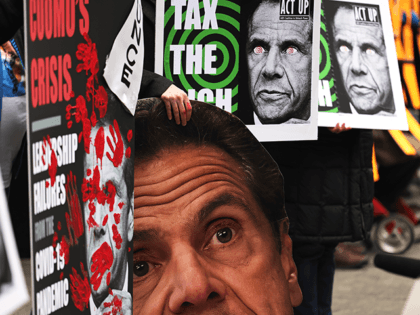 "People gather outside Gov. Andrew Cuomo's NYC office to protest against cuts to health care on March 01, 2021 in New York City. On the one-year anniversary of the first coronavirus (COVID-19) diagnosis in NYC, grassroots organizations gathered as part of the ""Invest In Our NY campaign!"" demanding Gov. Cuomo …"