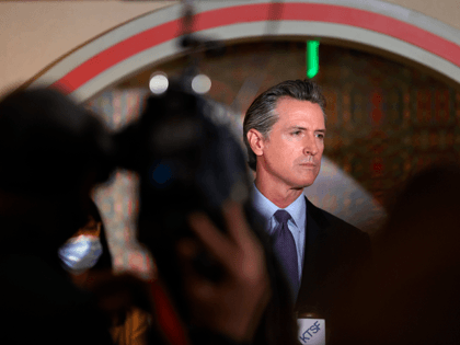 California Gov. Gavin Newsom (R) looks on during a news conference with Bay Area AAPI leaders at the Chinese Culture Center of San Francisco on March 19, 2021 in San Francisco, California. California Gov. Gavin Newsom met with San Francisco Bay Area AAPI leaders to discuss the increase in violence …