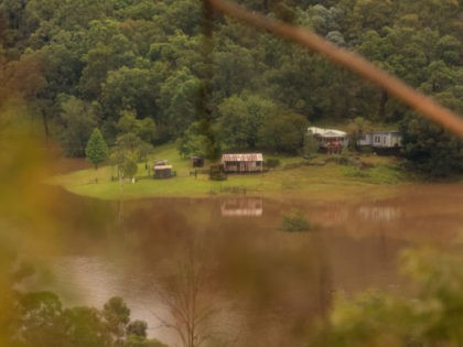 COLO, AUSTRALIA - MARCH 23: Properties are seen surrounded by floodwaters from the Colo river on March 23, 2021 in Colo, Australia. Evacuation warnings are in place for parts of Western Sydney as floodwaters continue to rise. (Photo by Jenny Evans/Getty Images)