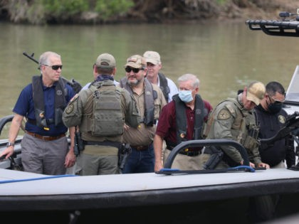 MISSION, TEXAS - MARCH 26: Sen. Ted Cruz (R-TX) and Sen. Lindsey Graham (R-SC) stand aboard a Texas Department of Public Safety boat for a tour of part of the Rio Grande river on March 26, 2021 in Mission, Texas. The senators are part of a Senate delegation visiting the …
