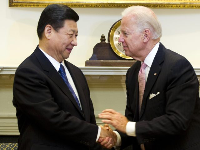US Vice President Joe Biden (R) shakes hands with Chinese Vice President Xi Jinping in the Roosevelt Room at the White House in Washington, DC, February 14, 2012. Xi, who arrived in Washington on Monday, is expected to succeed President Hu Jintao in 2013. Chinese presidents generally serve two five-year …