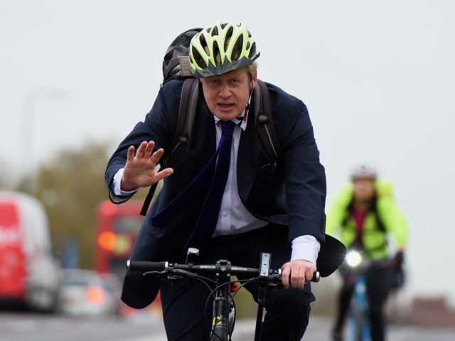 LONDON, ENGLAND - NOVEMBER 19: Mayor of London Boris Johnson cycles over Vauxhall Bridge to launch London's first cycle superhighway on November 19, 2015 in London, England. Superhighway 5 (CS5) is the capital's first two lane fully segregated cycle superhighway. (Photo by Ben Pruchnie/Getty Images)