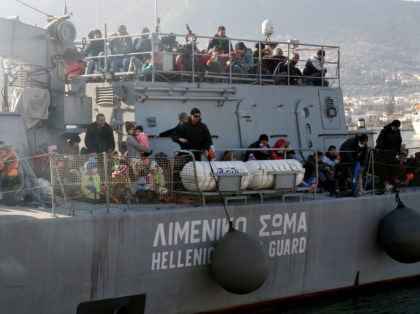 Migrants and refugees arrive aboard a Hellenic coast guard ship at the port of Lesbos island on February 8, 2016. Streams of people fleeing conflict or poverty continue to make the often perilous journey from Turkey across the Mediterranean and through the Balkans, despite cold winter weather, in the hope …