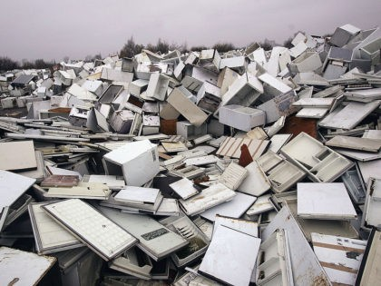 MANCHESTER, ENGLAND - NOVEMBER 24: A mountain of discarded fridges are shown at a fridge disposal site in Trafford Park Industrial area, on November 24, 2004 in Manchester, England. The firm contracted to organise the disposal went bust in March and left around 120,000 of the appliances rotting in storage.(Photo …