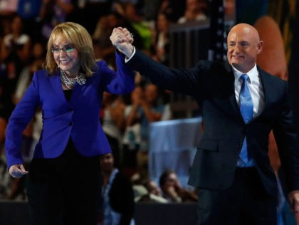 PHILADELPHIA, PA - JULY 27: Former Congresswoman Gabby Giffords walks on stage with her husband, retired NASA Astronaut and Navy Captain Mark Kelly, after delivering remarks on the third day of the Democratic National Convention at the Wells Fargo Center, July 27, 2016 in Philadelphia, Pennsylvania. Democratic presidential candidate Hillary …