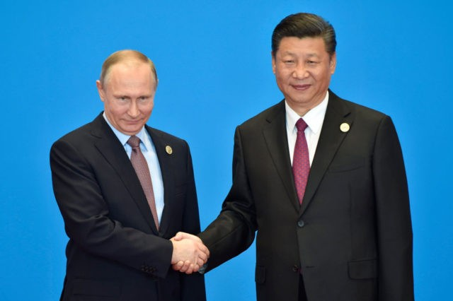 BEIJING, CHINA - MAY 15: Russian President Vladimir Putin (L) shakes hands with Chinese President Xi Jinping during the welcome ceremony for the Belt and Road Forum, at the International Conference Center on May 15, 2017 in Yanqi Lake, north of Beijing, China. (Photo by Kenzaburo Fukuhara-Pool/Getty Images)
