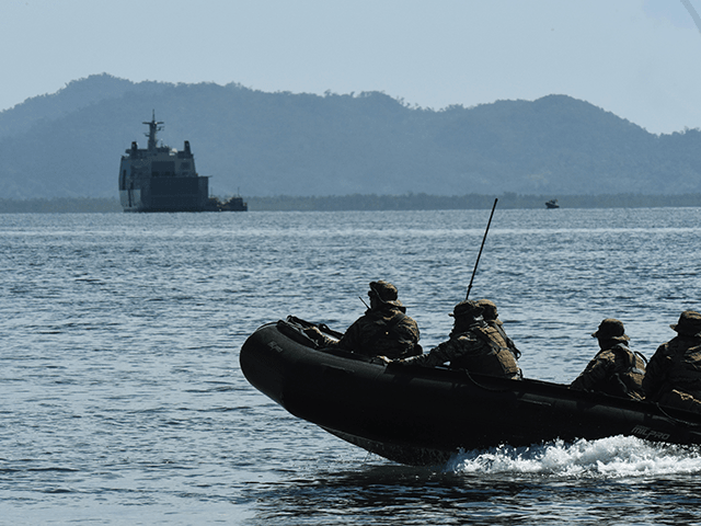 "A team of special warfare troops of the Philippine Navy patrol the coastline with the Philippine Navy ship, BRP Tarlac in the foreground on May 15, 2017 in Casiguran Province, Philippines. Philippines and U.S. troops held the annual ""Balikatan"" (shoulder-to-shoulder) joint military exercises with an approximately 6,000 participating troops, consisting …"