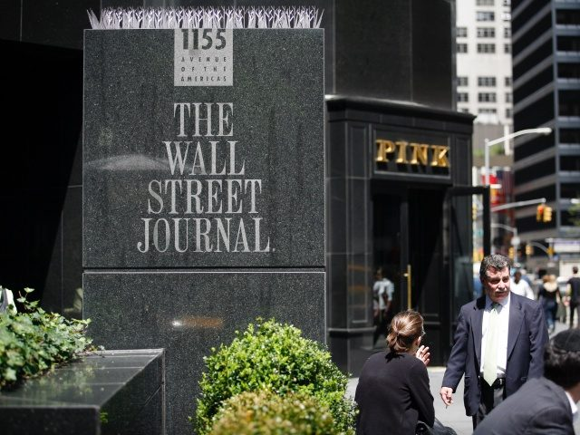 NEW YORK - May 01: Pedestrians walk past the Wall Street Journal building at 1155 6th Avenue on May 01, 2007 in New York City. Today the News Corporation made an unsolicited $5 billion bid for The Wall Street Journal. (Photograph by Michael Nagle/Getty Images)