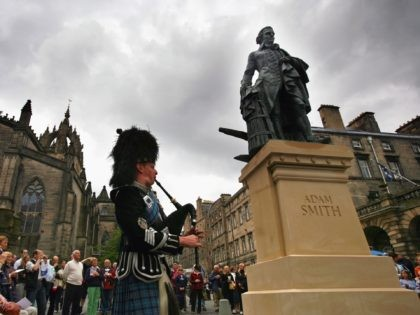 EDINBURGH, SCOTLAND - JULY 04: A crowd gather to watch the unveiling of a 10ft bronze statue of Scottish economist, philosopher and author Adam Smith (1723-1790) at the Royal Mile on July 4, 2008 in Edinburgh, Scotland. The statue, created by Alexander Stoddart, was unveiled in the heart of Edinburgh …