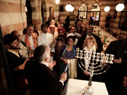 An interfaith group from the Gulf state of Bahrain attend Hannukah candle lighting in Jerusalem, Tuesday, Dec. 12, 2017. The 25 participants, which included Buddhists, Christians, Hindus, Sikhs, and both Sunni and Shiite Muslims, flew to Israel on Sunday as guests of the Simon Wiesenthal Center, a U.S.-based Jewish human …