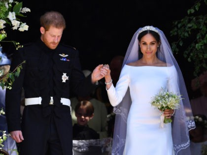 TOPSHOT - Britain's Prince Harry, Duke of Sussex and his wife Meghan, Duchess of Sussex emerge from the West Door of St George's Chapel, Windsor Castle, in Windsor, on May 19, 2018 after their wedding ceremony. (Photo by Ben STANSALL / POOL / AFP) (Photo credit should read BEN STANSALL/AFP …