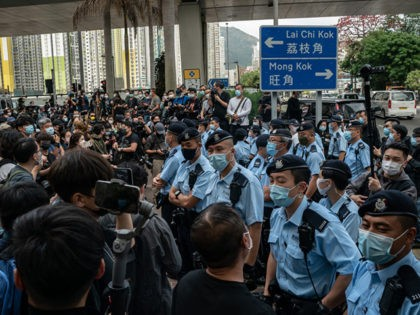 HONG KONG, HONG KONG - MARCH 1: Police officers stand guard as pro-democracy supporters gather outside the West Kowloon court on March 1, 2021 in Hong Kong. The protest took place during the court appearances by dozens of dissidents charged with subversion in the largest use of Beijing's sweeping new …