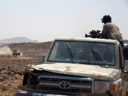 Forces loyal to Yemen's Saudi-backed government get into position during clashes with Huthi rebel fighters in Yemen's northeastern province of Marib on March 4, 2021. (Photo by - / AFP) (Photo by -/AFP via Getty Images)