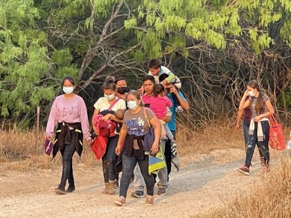 A group of migrant families search for a Border Patrol agent after crossing the Rio Grande near Mission, Texas. (Photo: Randy Clark/Breitbart Texas)