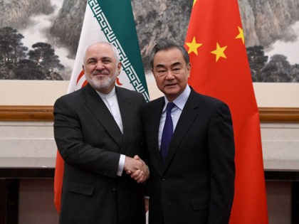 BEIJING, CHINA - DECEMBER 31: China's Foreign Minister Wang Yi shakes hands with Iran's Foreign Minister Mohammad Javad Zarif during a meeting at the Diaoyutai state guest house on December 31, 2019 in Beijing, China. (Photo by Noel Celis - Pool/Getty Images)