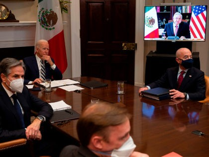 US President Joe Biden (C), flanked by US Secretary of State Antony Blinken (L) and US Secretary of Homeland Security Alejandro Mayorkas (R), meets virtually with Mexican President Andres Manuel Lopez Obrador at the White House in Washington, DC, on March 1, 2021. (Photo by JIM WATSON / AFP) (Photo …