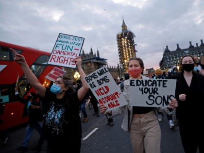 Protestors holding placards march on to Westminster Bridge as they demonstrate against the Government's Police, Crime, Sentencing and Courts Bill, being debated in the Houses of Parliament in London on March 15, 2021. - British Prime Minister Boris Johnson on Monday backed London's police chief following outrage over her officers' …
