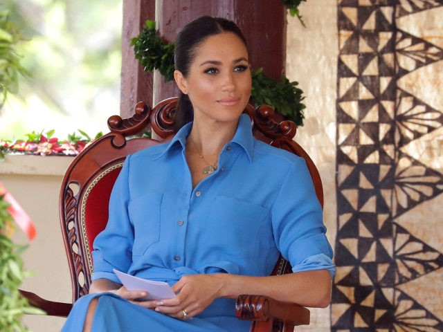 TUPOU COLLEGE TOLOA, TONGA - OCTOBER 26: Meghan, Duchess of Sussex talks with students during a visit to Tupou College in Tonga on October 26, 2018. Prince Harry and his wife Meghan are on day 11 of their 16-day tour of Australia and the South Pacific. (Photo by Kirsty Wigglesworth …
